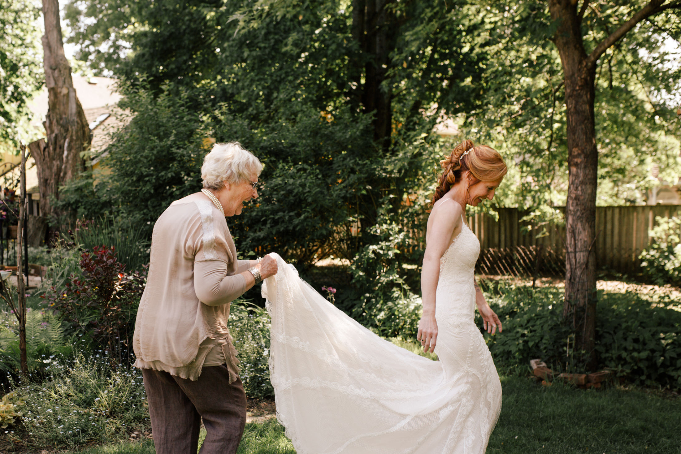 candid mother daughter wedding day image